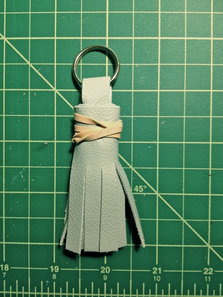 Blue tassle step 6- rubber band
